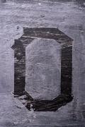 Black grunge alphabet. Letter O Stock Photos