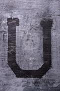 Black grunge alphabet. Letter U Stock Photos