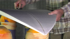 craftsman shaper of surfboards - stock footage