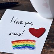 Text I love you moms written in a note Stock Photos