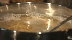 Stirring Fresh Pasta In Boiling Water 4K Stock Footage