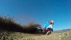 Low Angle Extreme Motocross Rider On Dirt Track Stock Footage