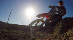 Slow Motion Motocross Rider On Dirt Track - stock footage