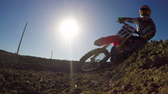Low Angle Extreme Motocross Rider On Dirt Track - stock footage