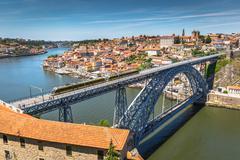 View of the historic city of Porto, Portugal with the Dom Luiz bridge. Stock Photos