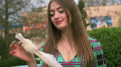 A young girl bites cotton candy Stock Footage