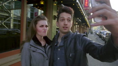 Cute young adults make funny faces for the camera - stock footage