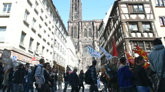 Strasbourg Cathedral and protesters Stock Footage