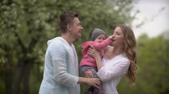 happy young family spending time outdoor - stock footage
