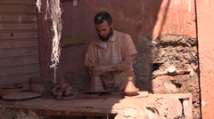 Potter making a tagine in Marrakesh Morocco Stock Footage