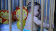 Cute baby playing in a crib Stock Footage