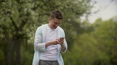 Young man talk to cellphone Stock Footage