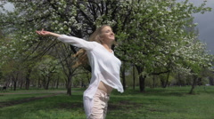 Woman with arms open enjoying her freedom Stock Footage