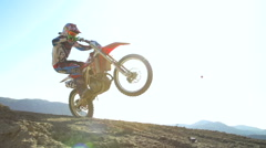 Extreme Motocross Racer Flying Over Jump In Slow Motion Stock Footage