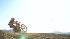 Slow Motion Motocross Rider Going Off Jump With Lens Flare Stock Footage