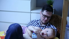 Father and son are playing in baby room Stock Footage