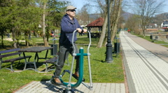 Middle aged man have a fun in an outdoor gym. Funny Stock Footage