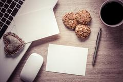 Blank notepad on wooden table - stock photo