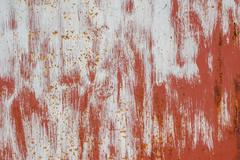 surface of rusty iron with remnants of old paint, great background or texture - stock photo