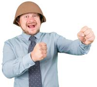 Businessman in military helmet fighting Kuvituskuvat