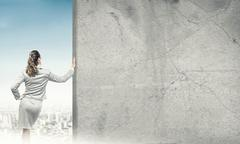 Woman and concrete empty banner Stock Photos