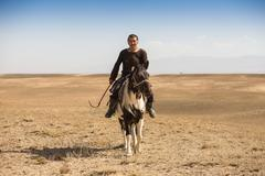 Normal steppe groom, who is tending the horses in Kazakhstan Stock Photos