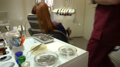 Young Woman in a Chair Dentist Dentistry Procedure, Doctor and Nurse at Work - stock footage