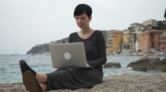 Woman  On The Seaside Working On The Computer - stock footage