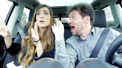 Crazy business people in car making funny pose and faces slow motion Stock Footage