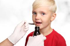 A child with a doctor, a cure for the flu. Stock Photos
