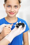 As you explore sugar? Baby measure blood glucose levels using a glucometer - stock photo