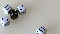 Playing dice, throw on the surface of white color. Dice of white and black. Stock Footage