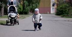 Mother and Her Baby Boy Walking Outside - stock footage