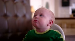 Baby Boy Sitting in High Chair Having Fun in Cafeteria Stock Footage