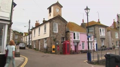 View of British streets with traditional red public phone booth and clock tower. Stock Footage
