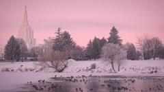 Idaho falls mormon LDS temple at dusk on Snake River Stock Footage