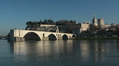 Rhone river with Pont d'Avignon bridge and Palais des Papes palace - stock footage