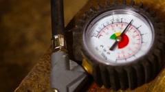 Tire pressure gauge Stock Footage