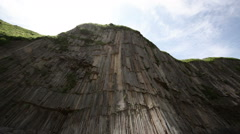 Lonely man shoots photo near Pillars cape rock Kunashir, Kuril islands Stock Footage