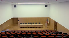 Auditorium for lectures with red chairs - stock footage