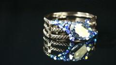 Bracelet with many stones on reflective background Stock Footage