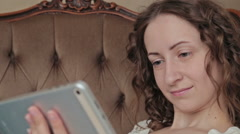 Woman using tablet Stock Footage