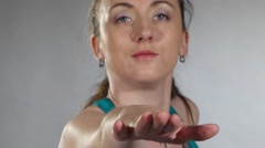Young fit woman stretching her arm and shoulder and then turns around Stock Footage