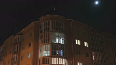 Multistorey apartment residential house at night Stock Footage