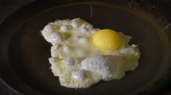 Fried eggs on red-hot frying pan. Kitchen café or restaurant Stock Footage