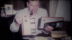 3208 dad opens his bithday presents at home - vintage film home movie - stock footage