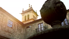Monastery cloister with church tower. Stock Footage