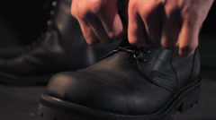Man ties boots Stock Footage
