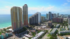 Skyscrapers on the beach Sunny Isles aerial video Stock Footage