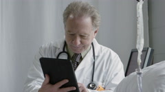 Physician using an ipad/tablet - stock footage